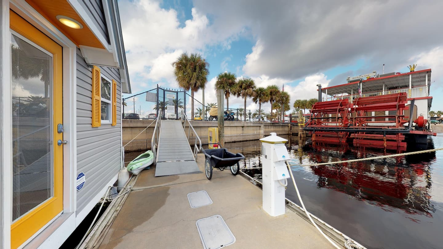 view of the walkway leading to the front door of the famous tiny houseboat